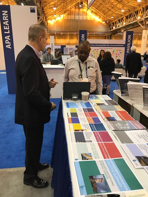 James Carpentier, AICP, talks with a planner at NPC18